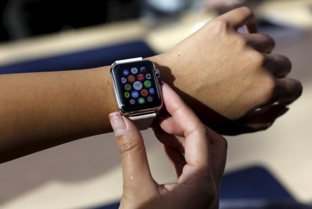A customer looks over an Apple Watch in Palo Alto, California April 10, 2015.