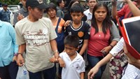 Children of Filipina drug convict and death row prisoner Mary Jane Veloso, Mark Darren, 6 (lower front C), Mark Daniel, 12 (C), along with other relatives arrive in Cilacap, to visit Nusakambangan maximum security prison island, on April 25, 2015