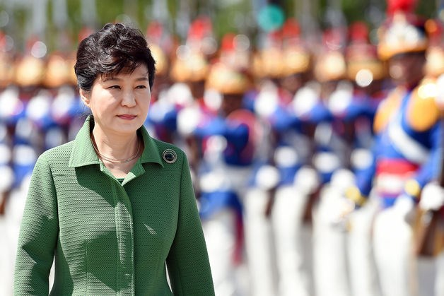 South Korean President Park Geun Hye reviews an honor guard as she arrives to meet Brazilian President Dilma Rousseff at the Presidential Palace in Brasilia on April 24.