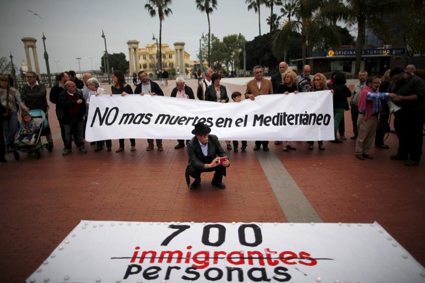 "People hold a banner that reads, ""No more deaths in the Mediterranean"" during a protest against the current immigration policy of the European Union, called by the ""Platform for solidarity with the immigrants of Malaga"", in Malaga, southern Spain, April 2"