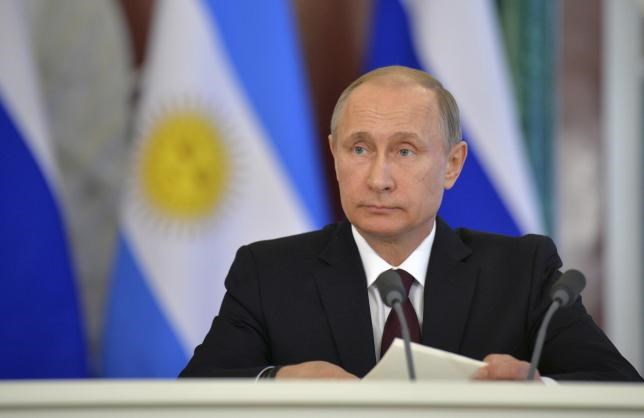 Russian President Vladimir Putin attends a signing ceremony on the results of Russian-Argentinian talks at the Kremlin in Moscow April 23, 2015.