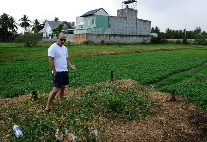 Landon Carnie pictured on on April 11, 2015 at the site on the outskirts of Ho Chi Minh City where the very first Babylift flight crashed on April 4, 1975, shortly after takeoff