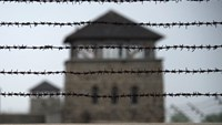 A barbed wire fence surrounds the former Nazi concentration camp Mauthausen in northern Austria