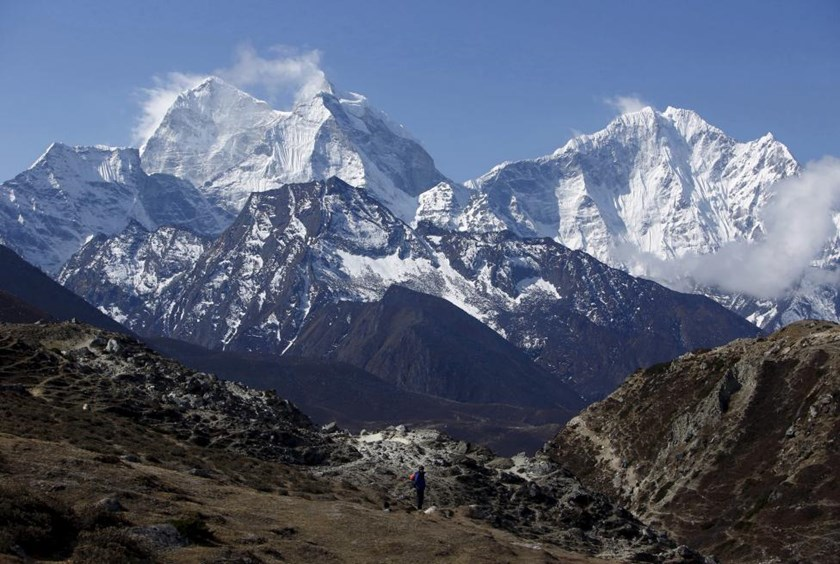 A trekker walks in front of Mount Thamserku while on his way back from Everest base camp near Pheriche in Solukhumbu District, in this file picture taken May 3, 2014.