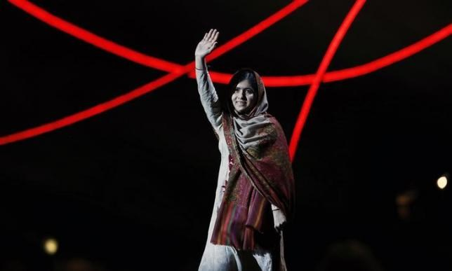 Nobel Peace Prize laureate Malala Yousafzai waves as she arrives on stage at the Nobel Peace Prize Concert in Oslo December 11, 2014.