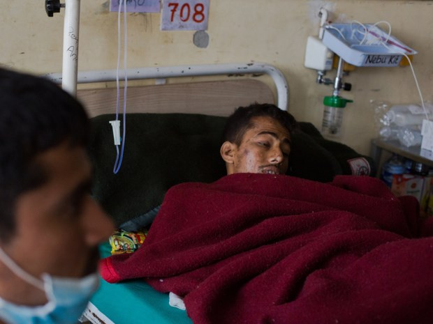 ImagesNepalese resident Rishi Khanal, 28, who was trapped in rubble for 82 hours following an earthquake, talks during an interview with AFP as he is treated at The Government Teaching Hospital in Kathmandu on April 30, 2015. Photo: AFP