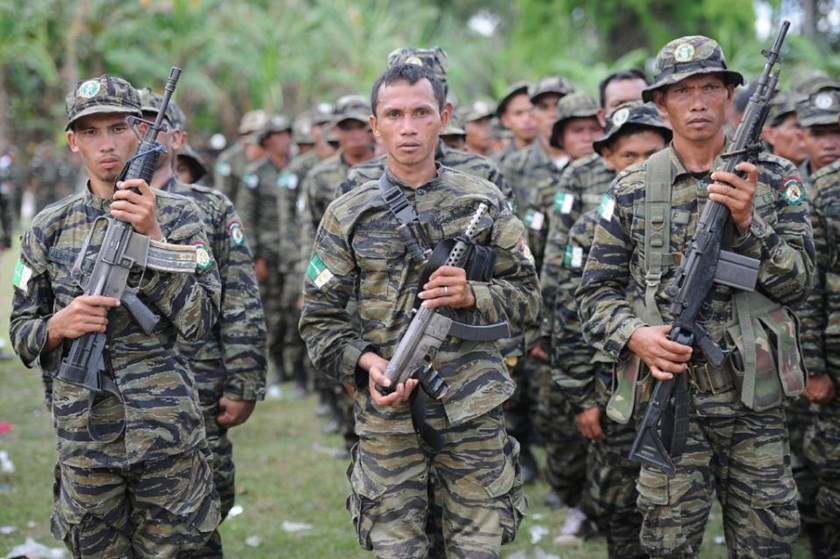 Moro Islamic Liberation Front (MILF) rebels attend a rally in support of the peace agreement with the government of the Philippines, inside Camp Darapanan in Sultan Kudarat town, on southern island of Mindanao, in March 2014