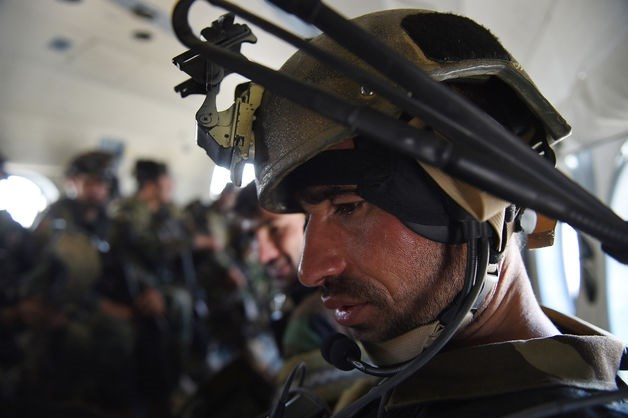 Afghan troops sit inside a helicopter in Kunduz, Afghanistan, on April 30.