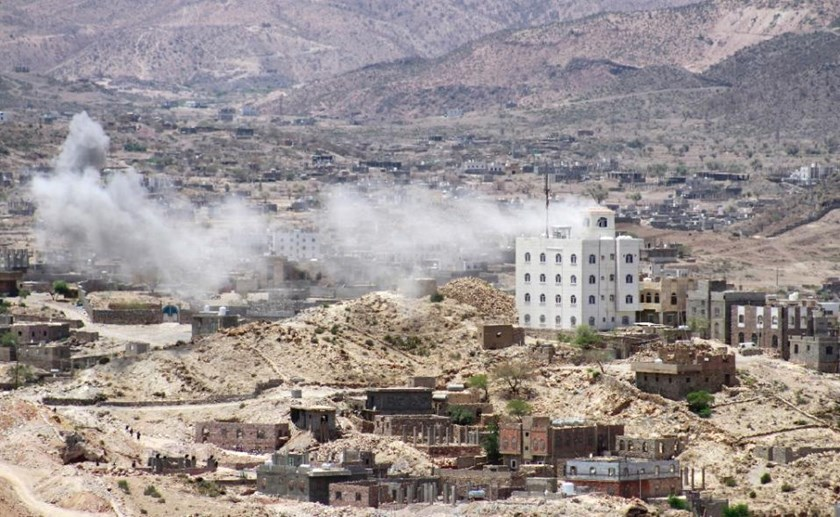 Smoke billows as supporters of exiled Yemeni President Abedrabbo Mansour Hadi clash with Shiite Huthi rebels on the outskirts of the Taez province, on May 3, 2015