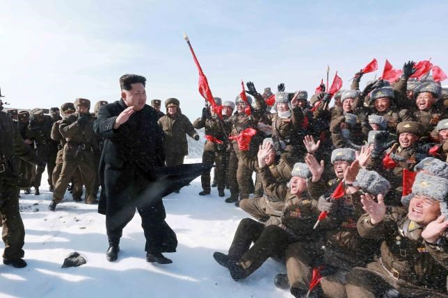 North Korean leader Kim Jong Un greets Korean People's Army pilots during a visit to the summit of Mt Paektu April 18, 2015, in this photo released by North Korea's Korean Central News Agency on April 19, 2015.