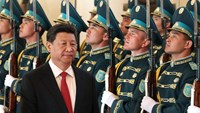 Chinese President Xi Jinping walks past an honor guard during a welcoming ceremony in Astana, Kazakhstan, on May 7.
