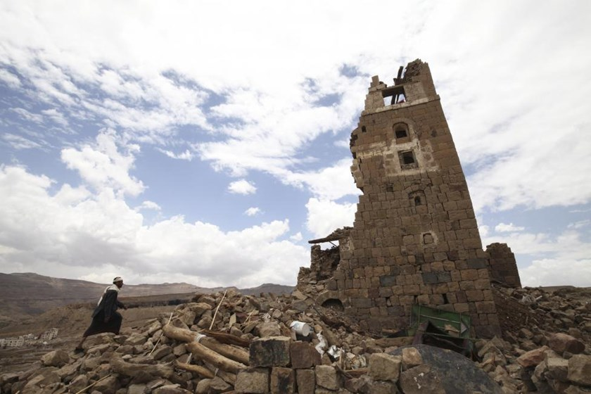 A man walks to a house that was damaged during an airstrike carried out by the Saudi-led coalition in Faj Attan village, Sanaa, Yemen May 7, 2015.