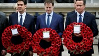 Britain's Prime Minister David Cameron (R) stands with former former Liberal Democrat leader Nick Clegg (C) and former Labour Party leader Ed Miliband, as they line up to pay tribute at the Cenotaph during a Victory in Europe (VE) day ceremony in central