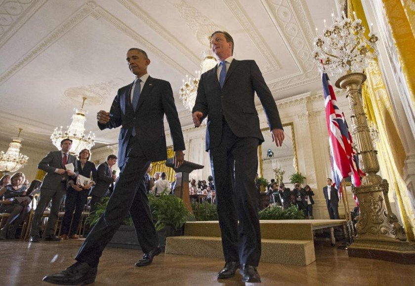 US President Barack Obama(L) and Britain's Prime Minister David Cameron make their way off the stage at the end of a press conference in the East Room of the White House on January 16, 2015 in Washington, DC