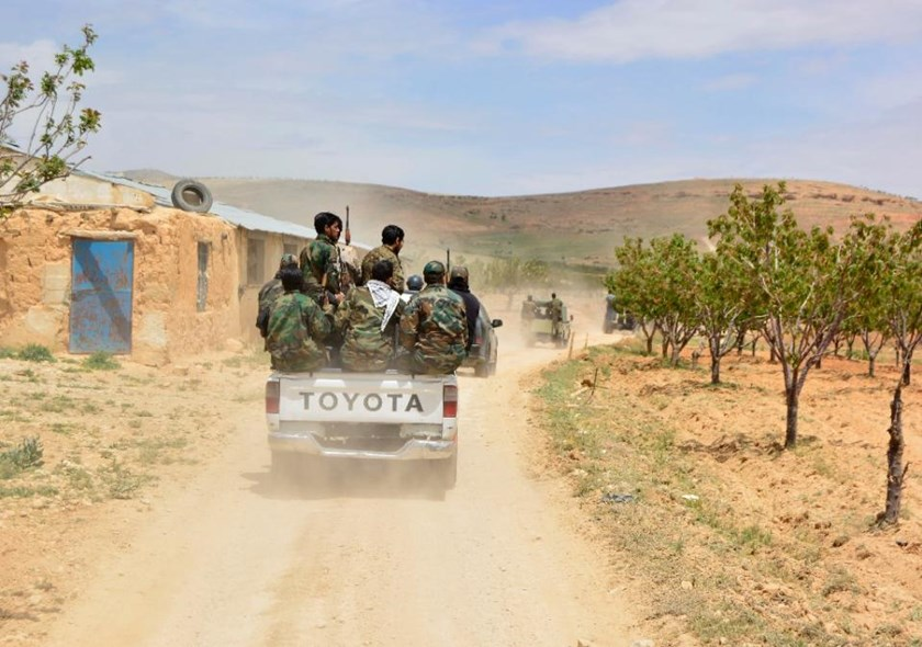 Syrian regime forces drive on May 9, 2015 near Assal al-Ward, in Qalamun region, after they seized control of parts of the area that straddles the Syria-Lebanon border