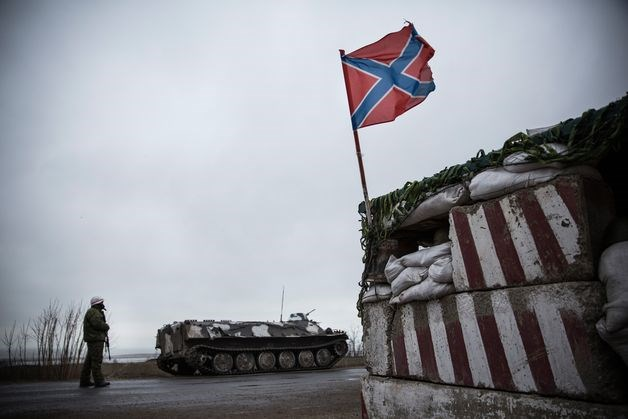 A pro-Russian seperatist stands guard at a check point on the road heading to Mariupol in Novoazovsk, Ukraine, on March 4.