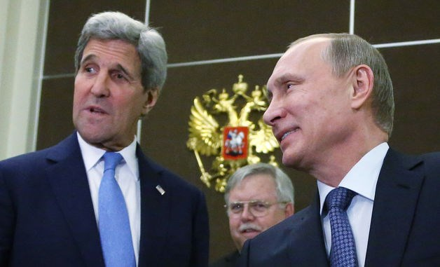 U.S. Secretary of State John Kerry, left, stands with with Russian President Vladimir Putin, right, during talks in Sochi, Russia, on May 12.