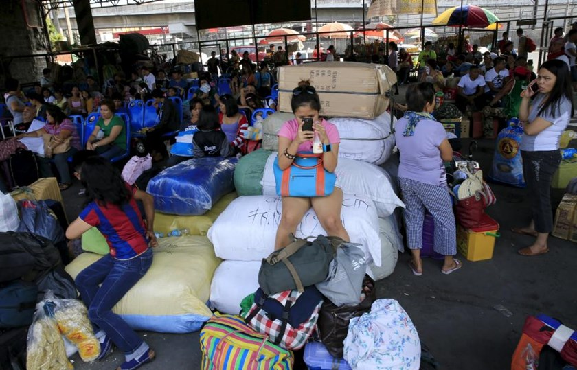 Stranded passengers guard their belongings while waiting at a bus terminal in Manila May 9, 2015.
