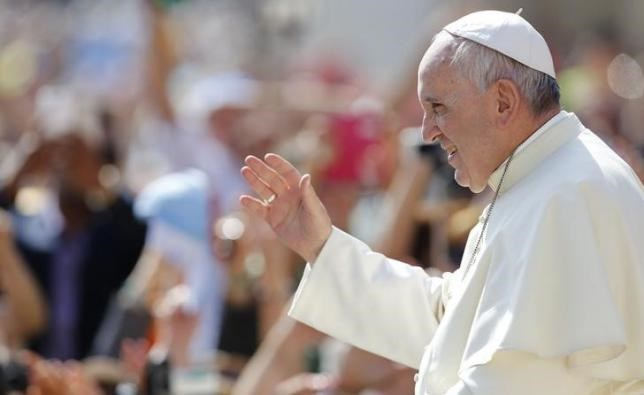 Pope Francis waves as he arrives to lead his weekly audience in St.Peter's square, at the Vatican City, May 13, 2015.