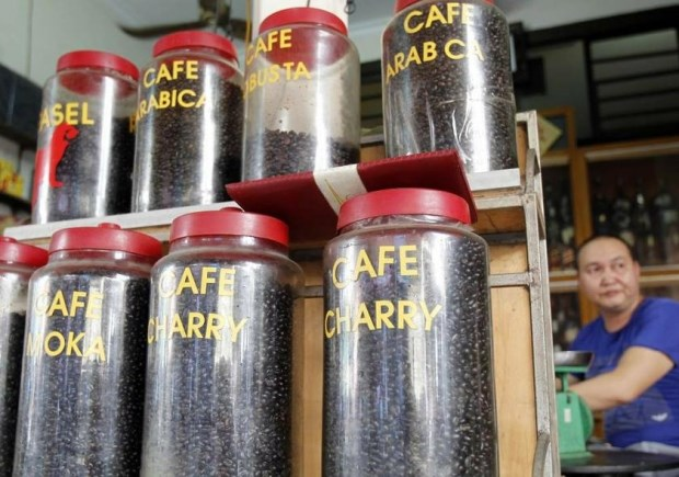 A coffee seller displays coffee beans for sale at a shop in Hanoi. Photo: Reuters