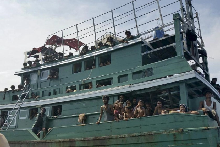 Hundreds of migrants are seen on a boat drifting 17 km (10 miles) off the coast of the southern island of Koh Lipe May 14, 2015.