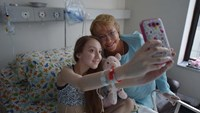 Handout picture released by the Chilean presidential press office showing President Michelle Bachelet posing for a selfie with Chilean child Valentina Maureira at a hospital in Santiago, on February 28, 2015
