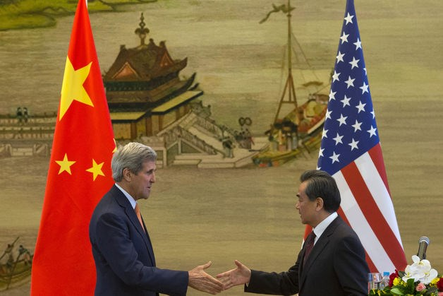 U.S. Secretary of State John Kerry And Counterpart Wang Yi