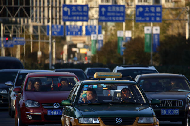 China tells raging drivers to cool it after woman kicked in head