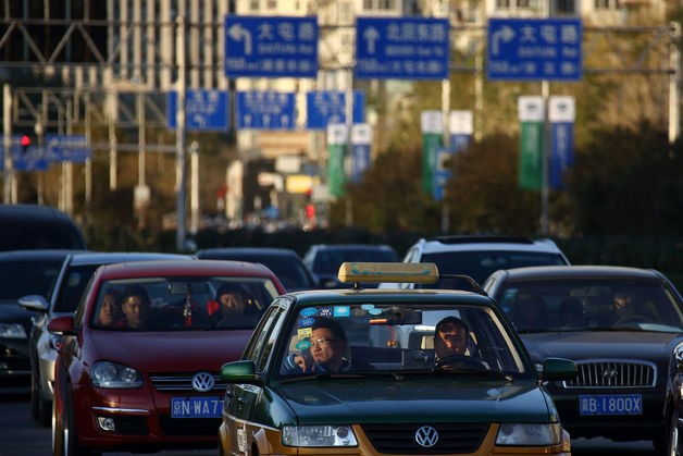Vehicles wait in traffic outside the China National Convention Center in Beijing. Photo: Bloomberg