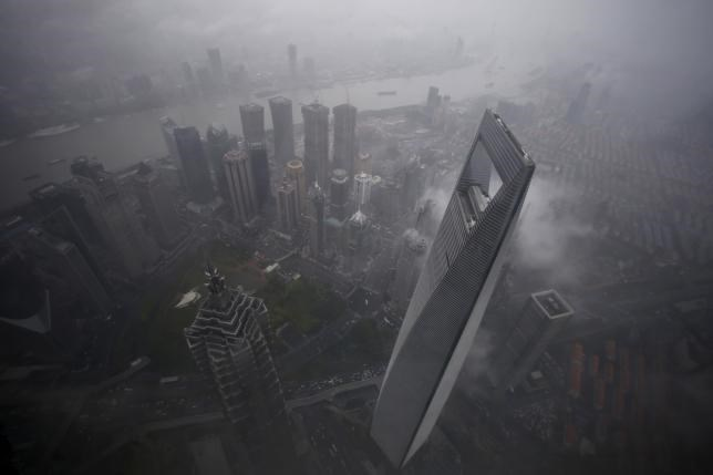 A general view of Shanghai's financial district of Pudong is seen from the top of the Shanghai Tower, during heavy rain at the financial district of Pudong in Shanghai May 15, 2015.
