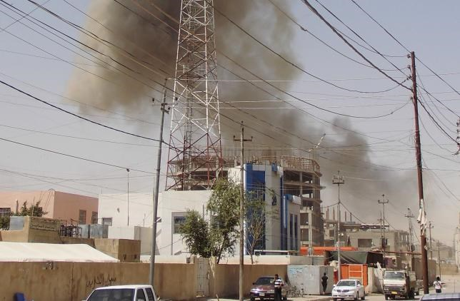 Smoke rises after a bomb attack in the city of Ramadi, May 15, 2015.