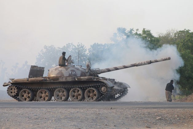 Armed Shiite Houthi rebels battling supporters of Yemen's Saudi-backed President Abdurabuh Mansur Hadi mans a tank on May 14, 2015. Photo: AFP