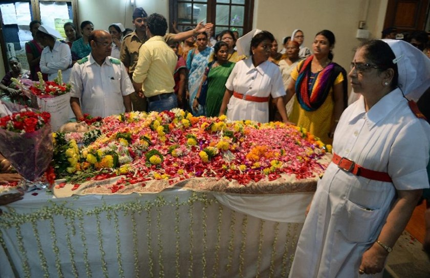 Indian nurses and hospital staff gather to pay their respect near the body of nurse Aruna Shanbaug at a hospital in Mumbai on May 18, 2015