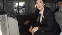 Ousted former Thai Prime Minister Yingluck Shinawatra sits in a van as she leaves the Supreme court in Bangkok, Thailand, May 19, 2015.