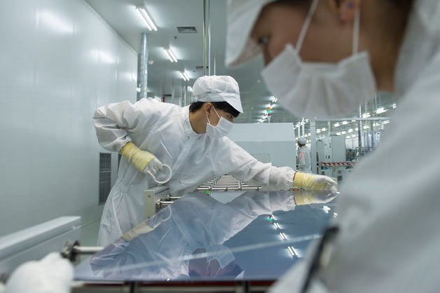 Chinese workers manufacture solar panels at the plant of Zhejiang Changxing Hanergy Solar PV Co., Ltd. in Huzhou city, east China's Zhejiang province. Source: Imaginechina