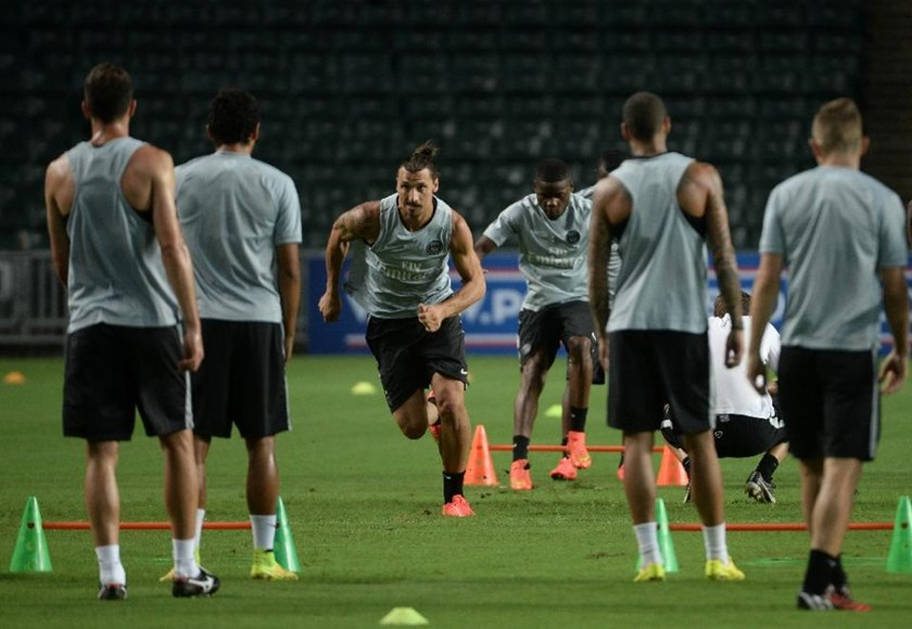 Paris Saint-Germain striker Zlatan Ibrahimovic (3rd left) runs a drill during a team training session in Hong Kong on July 28, 2014