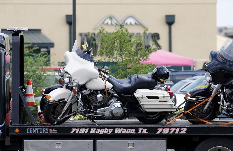 A motorcycle is seen on a wrecker before it is removed from the Twin Peaks restaurant, where nine members of a motorcycle gang were shot and killed, in Waco, May 19, 2015.