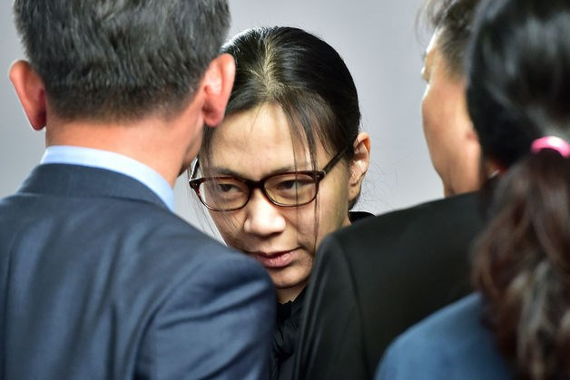 Former Korean Air executive Heather Cho is surrounded by journalists after she received a suspended jail sentence and was freed by a Seoul appeals court. Photo: AFP