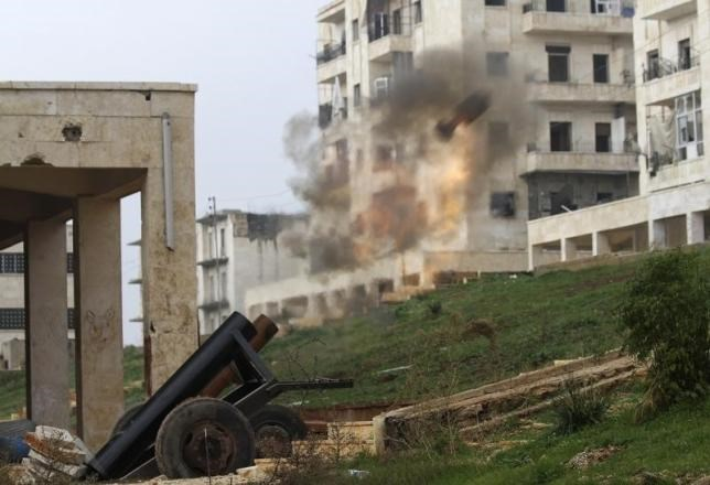 A locally made shell is launched by rebel fighters towards forces loyal to Syria's President Bashar al-Assad at the frontline in al-Breij district of Aleppo December 10, 2014.