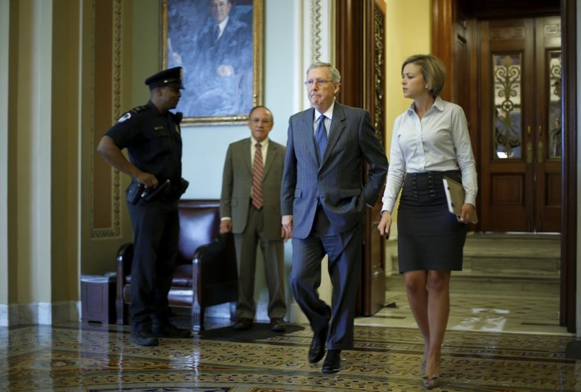 U.S. Senate Majority Leader Mitch McConnell (R-KY) (C) departs the Senate floor after a vote at the U.S. Capitol in Washington May 14, 2015.