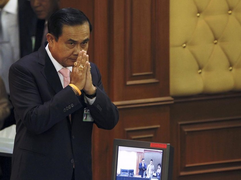 Thailand's Prime Minister Prayuth Chan-ocha gestures in a traditional greeting to National Legislative Assembly members at the parliament in Bangkok, Thailand, May 21, 2015.