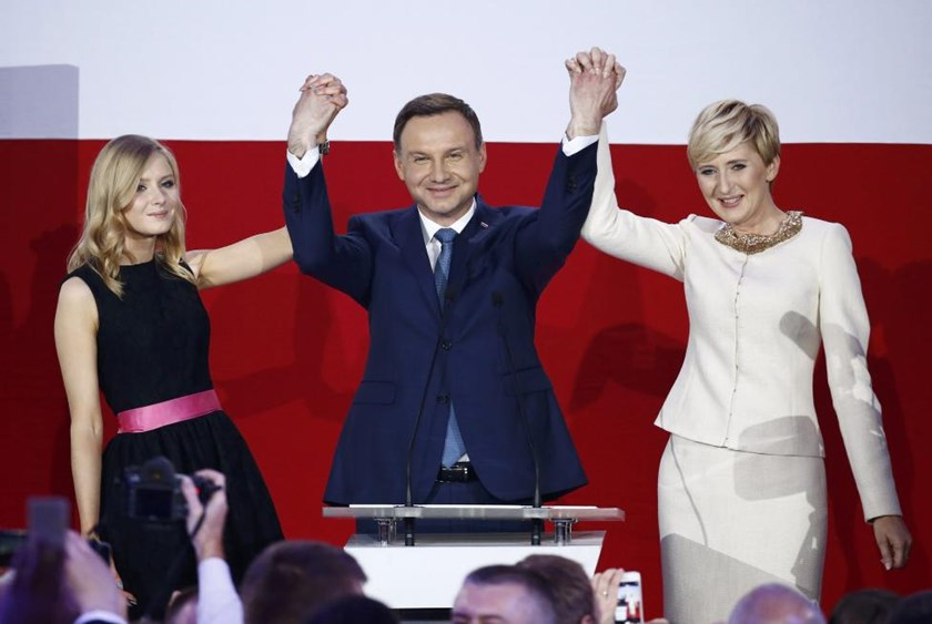 Andrzej Duda (C), celebrates with wife Agata (R) and their daughter Kinga