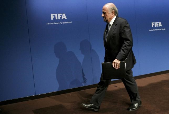 FIFA President Sepp Blatter leaves after a news conference at the FIFA headquarters in Zurich in this May 30, 2011 file picture.