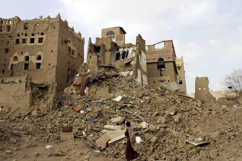 A man walks past houses damaged by Saudi-led airstrikes in Yemen's northwestern city of Saada May 26, 2015. Picture taken May 26, 2015.
