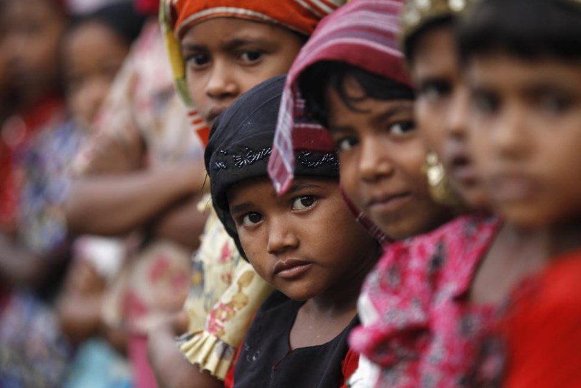 Rohingya Muslim children attend religious school at a refugee camp outside Sittwe, Myanmar May 21, 2015.