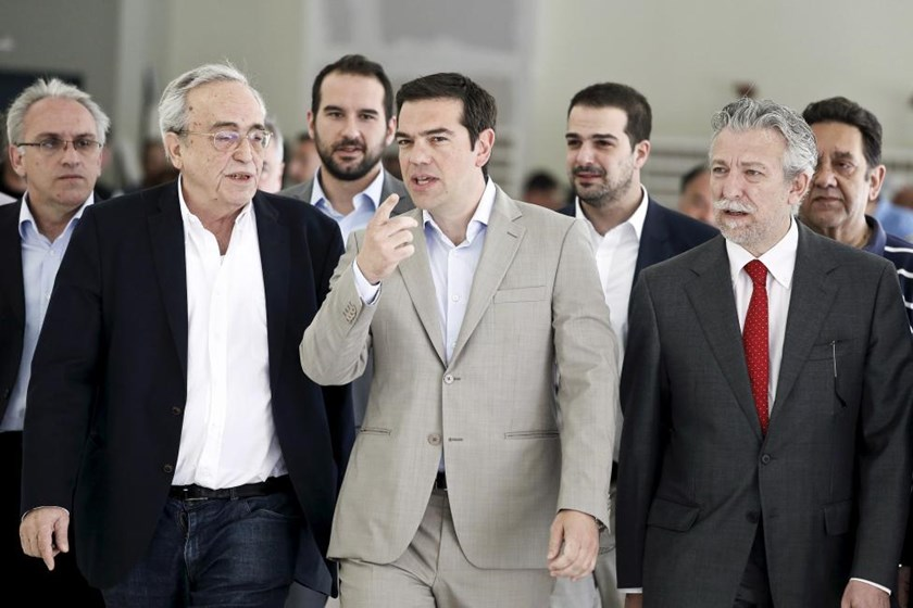 Greek Prime Minister Alexis Tsipras (C) gestures during his visit at the ministry in Athens June 2, 2015.