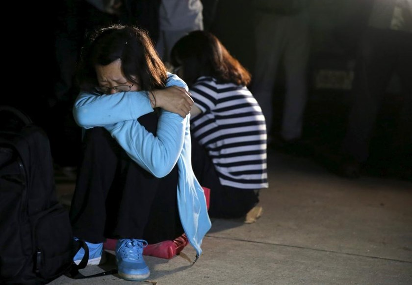 Family members of passengers of a sunken cruise ship cry after marching toward the site of the sunken ship in the Jianli section of Yangtze River, Hubei province, China, June 4, 2015.
