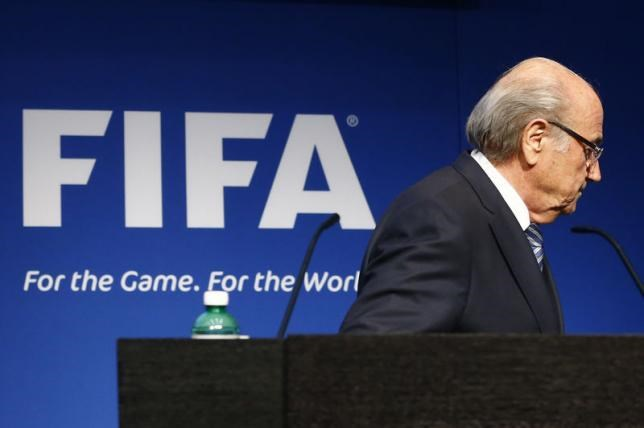 FIFA President Sepp Blatter leaves after his statement during a news conference at the FIFA headquarters in Zurich, Switzerland, June 2, 2015.