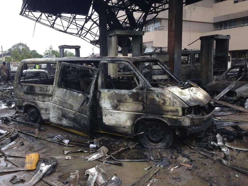 The charred wreckage of a minivan is seen at a gas station that exploded overnight killing around 90 people in Accra, Ghana, June 4, 2015.