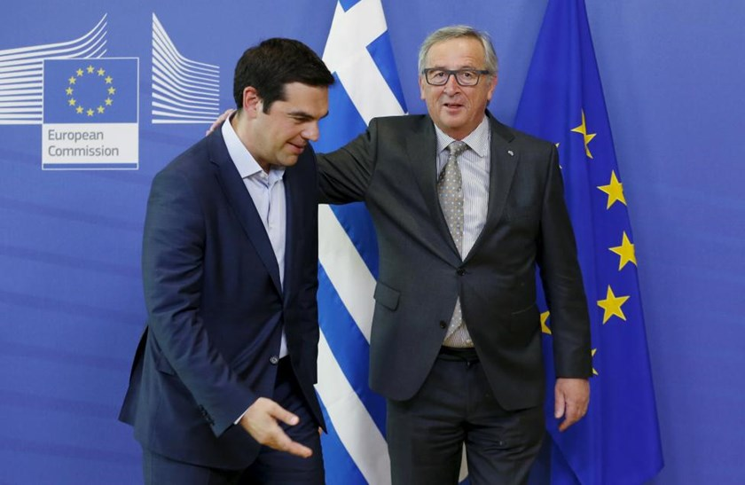 Greek Prime Minister Alexis Tsipras (L) poses with European Commission President Jean-Claude Juncker ahead of a meeting at the EU Commission headquarters in Brussels, Belgium, June 3, 2015.